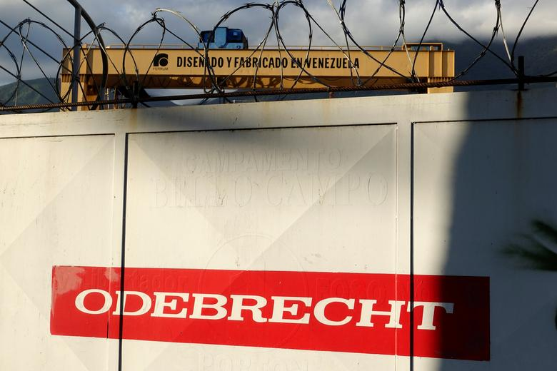 The corporate logo of Odebrecht is seen next to a text in a structure that reads ''Designed and made in Venezuela'' in a construction site in Caracas, Venezuela January 26, 2017. REUTERS/Carlos Garcia Rawlins