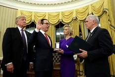 U.S. President Donald Trump (L) watches as Vice President Mike Pence (R) swears in Steve Mnuchin as Treasury Secretary next to his fiancée Louise Linton in the Oval Office of the White House in Washington February 13, 2017. REUTERS/Yuri Gripas