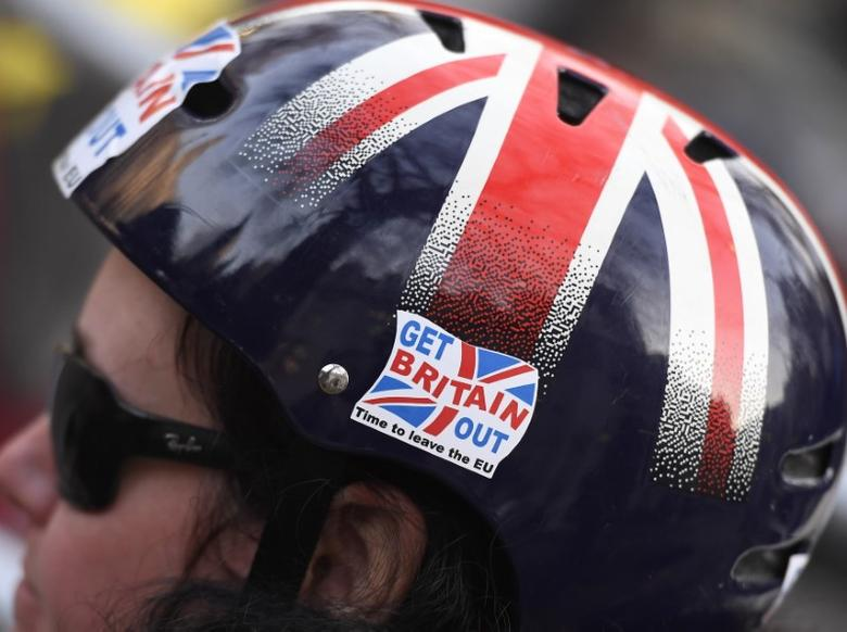 A cyclist wears a pro-Brexit badge on her Union flag themed helmet in Parliament Square, central London, Britain December 5, 2016. REUTERS/Toby Melville