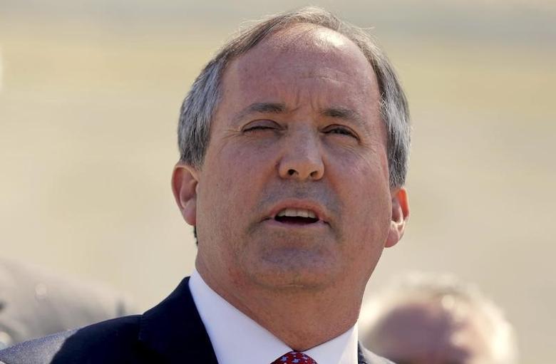 File Photo: Texas Attorney General Ken Paxton speaks outside the U.S. Supreme Court in Washington, D.C., U.S. April 18, 2016.      REUTERS/Joshua Roberts/File Photo -