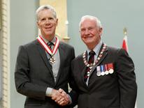 File Photo: Radio broadcaster Stuart McLean (L) shakes hands with Governor General David Johnston after being awarded the rank of Officer in the Order of Canada at Rideau Hall in Ottawa September 28, 2012.  REUTERS/Chris Wattie/File Photo
