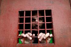 Amaar Hussein, 22,  an Islamic State member  look out from a prison cell  in Sulaimaniya , Iraq February 15, 2017. REUTERS/Zohra Bensemra