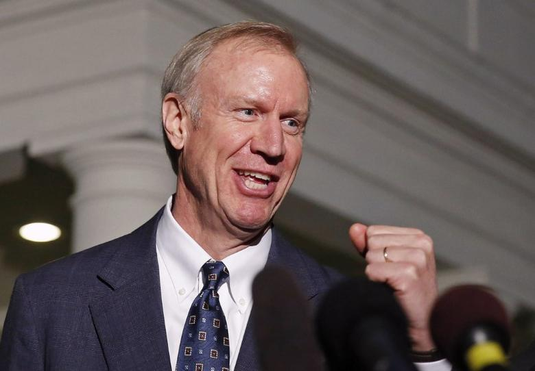 Illinois Gov-elect Bruce Rauner talks to the media after a meeting with U.S. President Barack Obama at the White House in Washington December 5, 2014.       REUTERS/Larry Downing/File Photo -