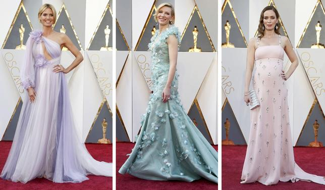 Heidi Klum, Cate Blanchett and Emily Blunt pose on the red carpet before the 2016 Academy Awards.  REUTERS/Staff
