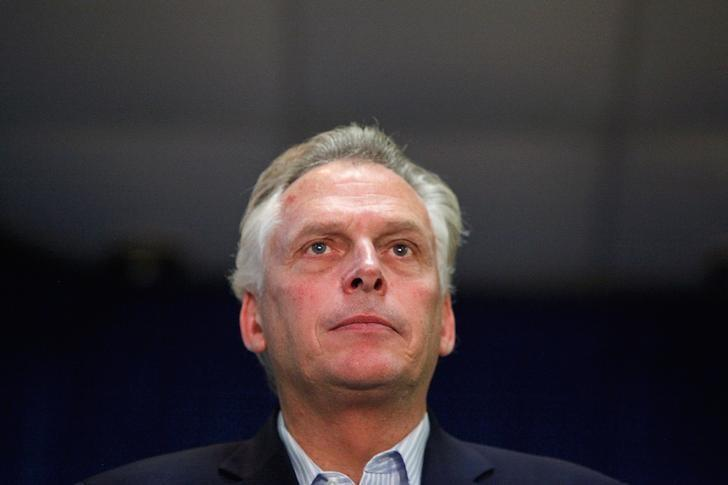 FILE PHOTO --  Democratic nominee for Virginia governor Terry McAuliffe stands onstage during a campaign rally in Dale City, Virginia, October 27, 2013.  REUTERS/Jonathan Ernst/File Photo