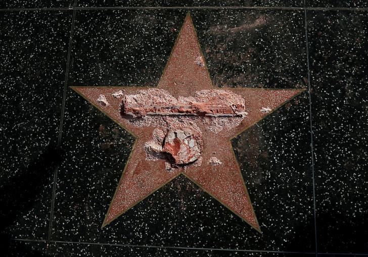 Donald Trump's star on the Hollywood Walk of Fame is seen after it was vandalized in Los Angeles, California U.S., October 26, 2016.   REUTERS/Mario Anzuoni/File Photo