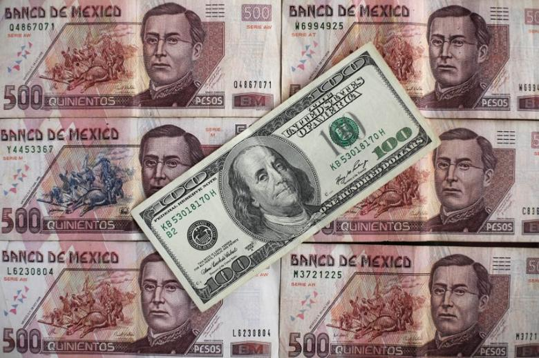 Mexican peso and U.S. dollar banknotes are seen in this picture illustration, November 3, 2016. REUTERS/Edgard Garrido