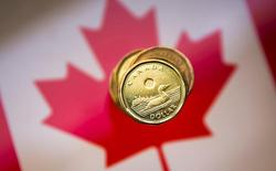 "A Canadian dollar coin, commonly known as the ""Loonie"", is pictured in this illustration picture taken in Toronto January 23, 2015.   REUTERS/Mark Blinch/File Photo"