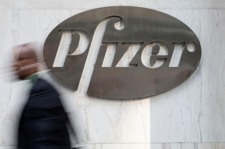 A man walks past Pfizer's world headquarters in New York April 28, 2014. REUTERS/Andrew Kelly/File Photo