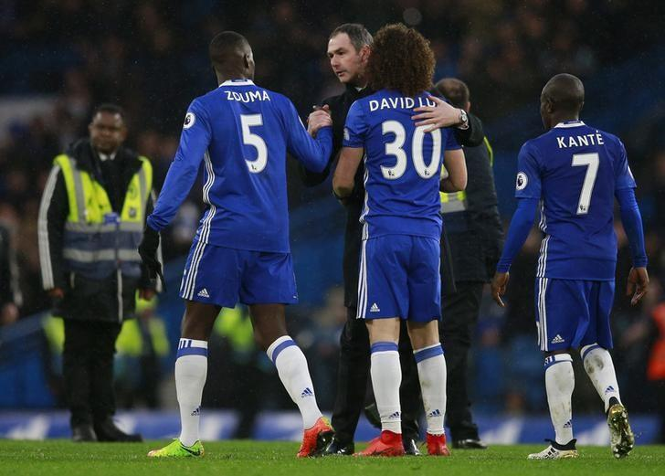 Britain Football Soccer - Chelsea v Swansea City - Premier League - Stamford Bridge - 25/2/17 Swansea City manager Paul Clement with Chelsea's David Luiz and Kurt Zouma after the game  Reuters / Peter Nicholls Livepic
