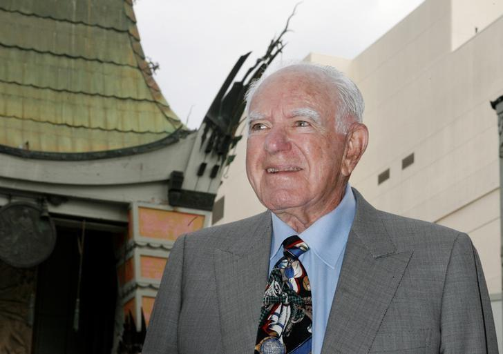 Judge Joseph A. Wapner, former host of the television series ''The People's Court'' poses with Graumans Chinese theater in background before ceremonies unveiling his star on the Hollywood Walk of Fame in Hollywood, California November 12, 2009. REUTERS/Fred Prouser/File Photo