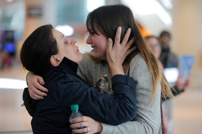 Shanez Tabarsi (L) is greeted by her daughter Negin after traveling to the U.S. from Iran following a federal court's temporary stay of U.S. President Donald Trump's executive order travel ban at Logan Airport in Boston, Massachusetts, U.S. February 6, 2017.   REUTERS/Brian Snyder