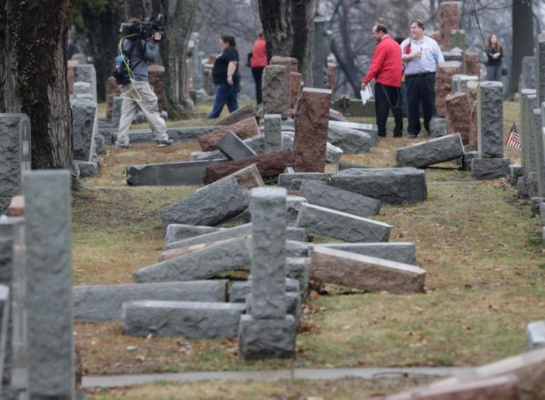 Local and national media report on more than 170 toppled Jewish headstones after a weekend vandalism attack on Chesed Shel Emeth Cemetery in University City, a suburb of St Louis, Missouri, U.S. February 21, 2017.  REUTERS/Tom Gannam -