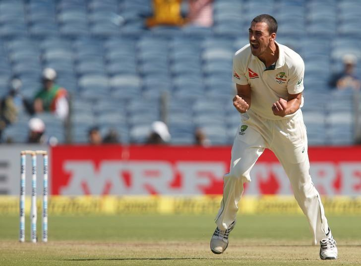 Cricket - India v Australia - First Test cricket match - Maharashtra Cricket Association Stadium, Pune, India - 24/02/17. Australia's Mitchell Starc celebrates the wicket of India's captain Virat Kohli. REUTERS/Danish Siddiqui/Files