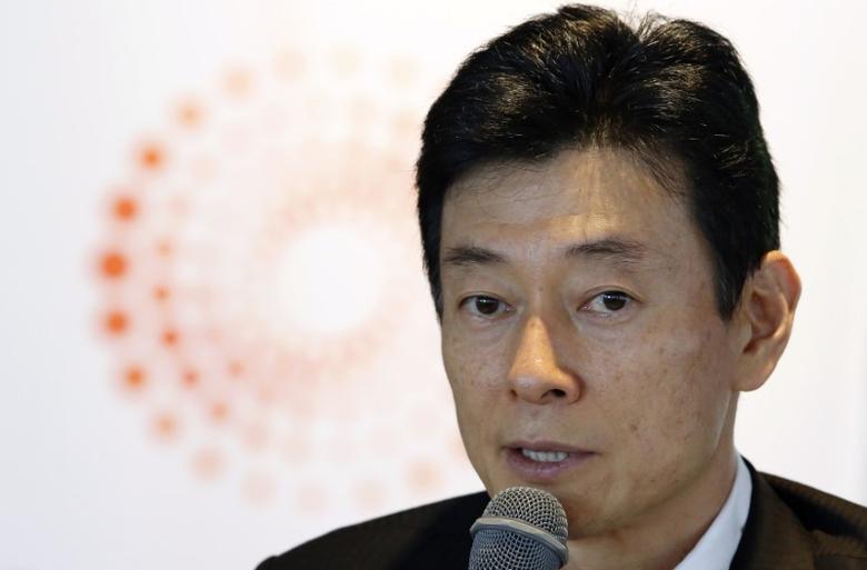 Yasutoshi Nishimura speaks during the Reuters Japan Investment Summit in Tokyo May 19, 2014.   REUTERS/Toru Hanai