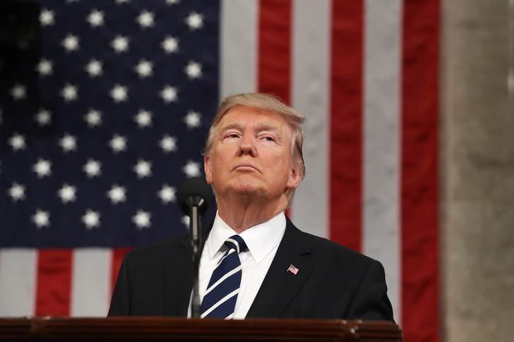 U.S. President Donald Trump delivers his first address to a joint session of Congress from the floor of the House of Representatives iin Washington, U.S., February 28, 2017.  REUTERS/Jim Lo Scalzo/Pool/Files