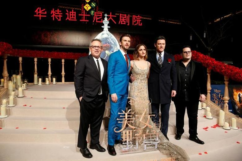 Director Bill Condon and actors Dan Stevens, Emma Watson, Luke Evans, and Josh Gad (L-R) pose for photographers on the red carpet for the film ''Beauty and the Beast'' in Shanghai, China February 27, 2017. REUTERS/Aly Song -