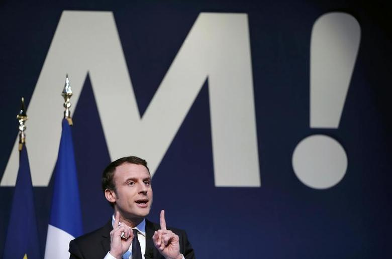 Emmanuel Macron, head of the political movement En Marche !, or Onwards !, and candidate for the 2017 French presidential election, speaks during a news conference to unveil his fully budgeted manifesto, named a ''contract with the nation'', in Paris, France, March 2, 2017.    REUTERS/Christian Hartmann