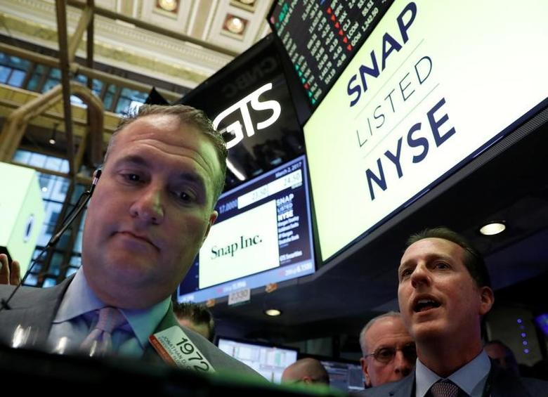 Specialist Trader Glen Carell (R) gives a price for Snap Inc. during the company's IPO on the floor of the New York Stock Exchange (NYSE) in New York, U.S., March 2, 2017. REUTERS/Brendan McDermid