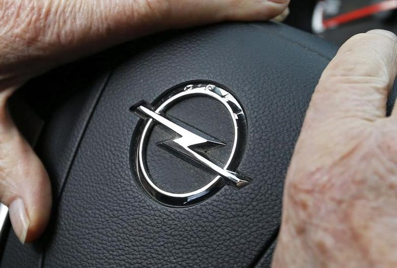 An Opel logo is seen on the steering wheel of a car in Bordeaux, France, February 20, 2017. REUTERS/Regis Duvignau/Files