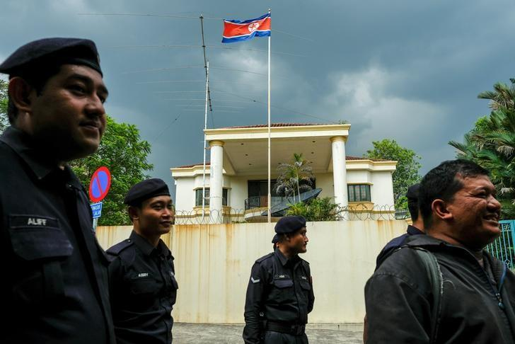 FILE PHOTO: Malaysian police officers gather before a protest organized by members of the youth wing of the National Front, Malaysia's ruling coalition, in front of the North Korea embassy, following the murder of Kim Jong Nam, in Kuala Lumpur, Malaysia, February 23, 2017. REUTERS/Athit Perawongmetha/File Photo