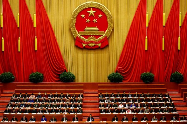 FILE PHOTO:  China's President Xi Jinping and other delegates listen as China's Premier Li Keqiang (not pictured) delivers a government work report during the opening session of the National People's Congress (NPC) at the Great Hall of the People in Beijing, China, March 5, 2017.   REUTERS/Damir Sagolj/File Photo