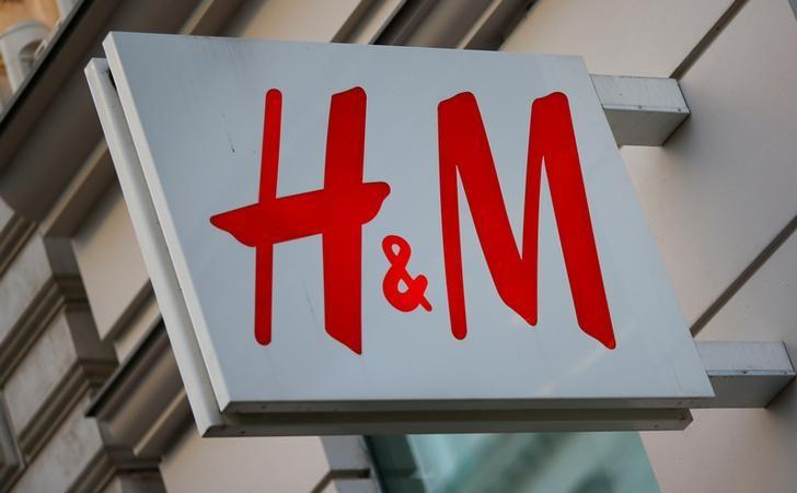 The logo of Swedish fashion lebel H&M is seen outside a store in Vienna, Austria, October 1, 2016. REUTERS/Leonhard Foeger/Files