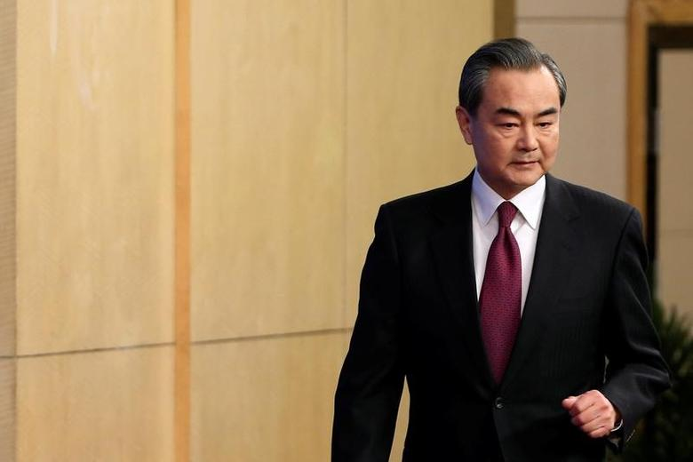 Chinese Foreign Minister Wang Yi attends an news conference at the annual session of the National People's Congress (NPC), in Beijing, China March 8, 2017. REUTERS/Tyrone Siu