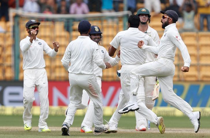 Cricket - India v Australia - Second Test cricket match - M Chinnaswamy Stadium, Bengaluru, India - 07/03/17 - India's captain Virat Kohli (R) celebrates the wicket of Australia's Mitchell Marsh with team mates. REUTERS/Danish Siddiqui