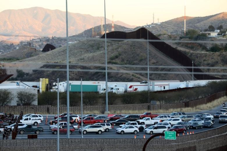 Trucks and cars cross the border from Mexico into the U.S. in Nogales, Arizona, U.S., January 30, 2017. REUTERS/Lucy Nicholson