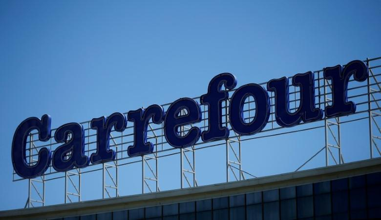 FILE PHOTO: The logo of France-based food retailer Carrefour is seen on the roof of Tbilisi Mall in Tbilisi, Georgia, April 22, 2016. REUTERS/David Mdzinarishvili/File Photo