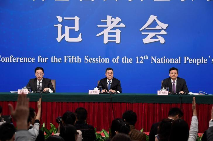 (L-R) Wang Aili, Director-General of the Office of Criminal Laws of the Legislative Affairs Commission of the National People's Congress (NPC) Standing Committee, Zhang Rongshun, Vice Chairman of the Legislative Affairs Commission of NPC Standing Committee, Xu Anbiao, Vice Chairman of the Legislative Affairs Commission of NPC Standing Committee, hold a news conference on the sidelines of the NPC, in Beijing, China, March 9, 2017. REUTERS/Stringer
