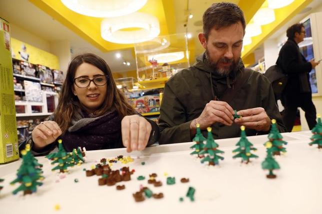 People building Lego christmas trees in the world's biggest Lego store in Leicester Square in London, Britain November 17, 2016. REUTERS/Stefan Wermuth