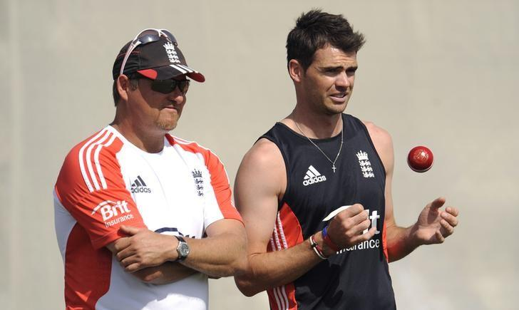 England's James Anderson throws a ball up as he stands with bowling coach David Saker (L) during a training session at the ICC Global cricket academy before the third cricket test match against Pakistan in Dubai, United Arab Emirates February 1, 2012. REUTERS/Philip Brown/File Photo