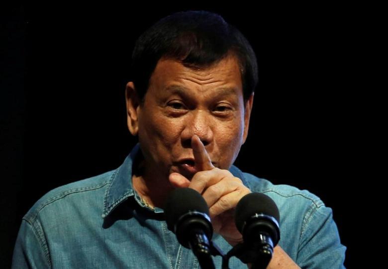 Philippine President Rodrigo Duterte speaks before Philippine Councilors League in Pasay city, Metro Manila, Philippines March 8, 2017.    REUTERS/Erik De Castro