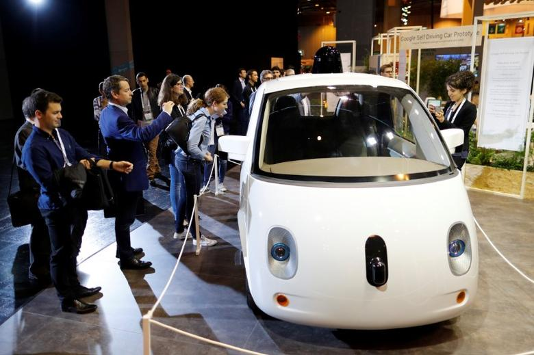 Visitors look at a self-driving car by Google displayed at the Viva Technology event in Paris, France, July 1, 2016. REUTERS/Benoit Tessier