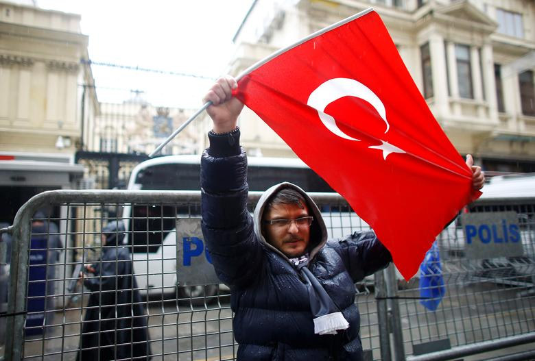 A demonstrator holds a Turkish flag during a protest in front of the Dutch Consulate in Istanbul, Turkey, March 12, 2017. REUTERS/Osman Orsal