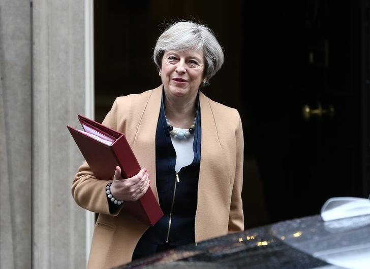 Britain's Prime Minister Theresa May leaves 10 Downing Street before Chancellor of the Exchequer Philip Hammond delivers his budget to the House of Commons in London, Britain March 8, 2017.     REUTERS/Neil Hall