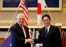 U.S. Secretary of State Rex Tillerson (L) shakes hands with Japan's Foreign Minister Fumio Kishida before their meeting at the foreign ministry's Iikura guest house in Tokyo, Japan, March 16, 2017.   REUTERS/Toru Hanai