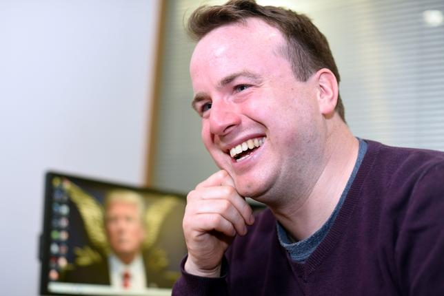 FILE PHOTO: Matt Forde talks about his TV show ''Unspun'' in an interview at Reuters' office in Canary Wharf, London, Britain March 1, 2017. ''Unspun'' is a political comedy show that includes real and fake interviews as well as Forde's impression of U.S. President  Donald Trump, among others.  REUTERS/Andrew Heavens/File Photo