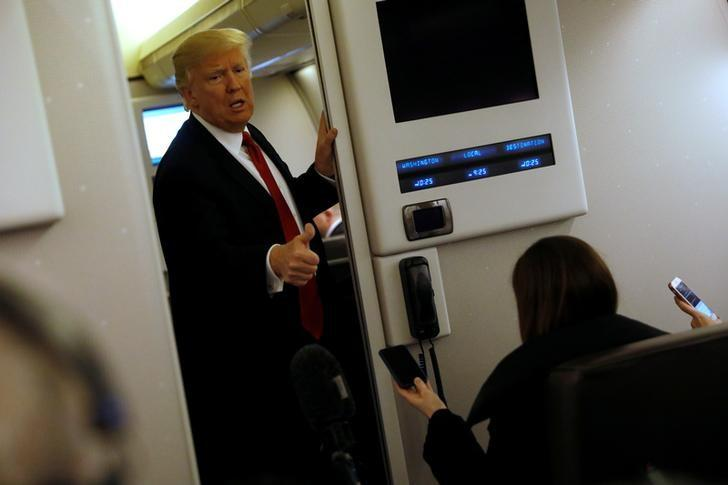 U.S. President Donald Trump speaks to reporters aboard Air Force One as they approach Joint Base Andrews, Maryland, U.S. March 15, 2017. REUTERS/Jonathan Ernst
