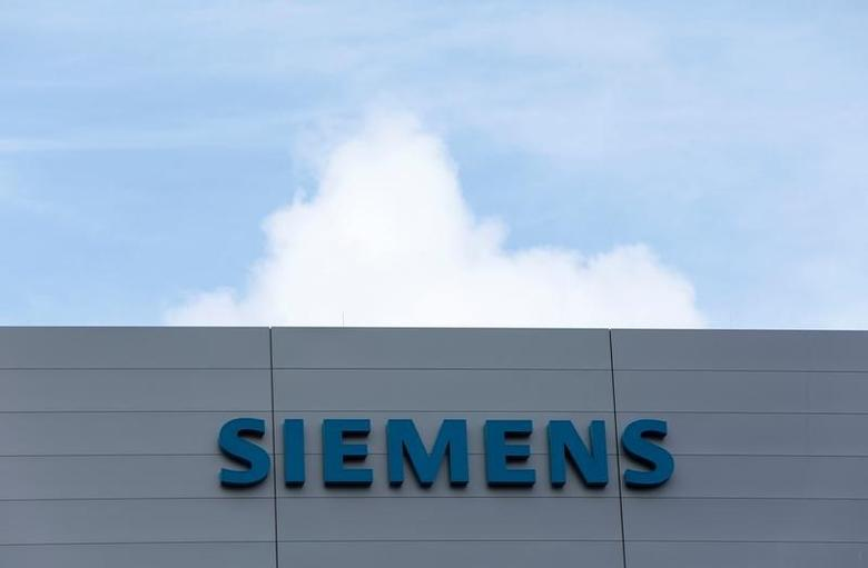 Siemens logo is pictured at a building of the manufacturing plant of Siemens Healthineers in Forchheim near Nuremberg, Germany, October 7, 2016. REUTERS/Michaela Rehle