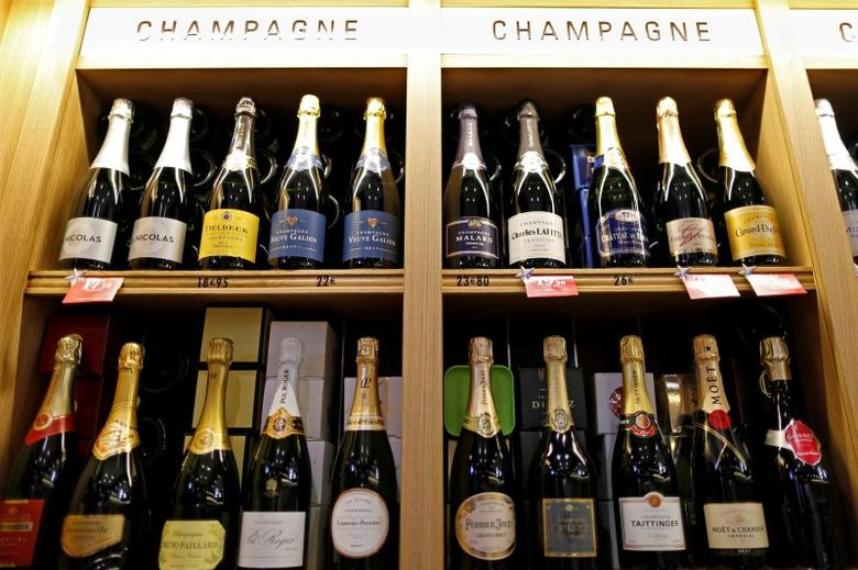 Bottles of champagne are displayed December 21, 2016 at a Nicolas French wine specialist store in Paris, France.   REUTERS/Charles Platiau