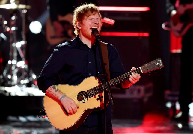 FILE PHOTO: British singer Ed Sheeran performs during the 'Golden Camera' ('Die Goldene Kamera') award ceremony of German TV magazine 'Hoer Zu' in Hamburg, March 4, 2017.  REUTERS/Christian Charisius/Pool/File Photo