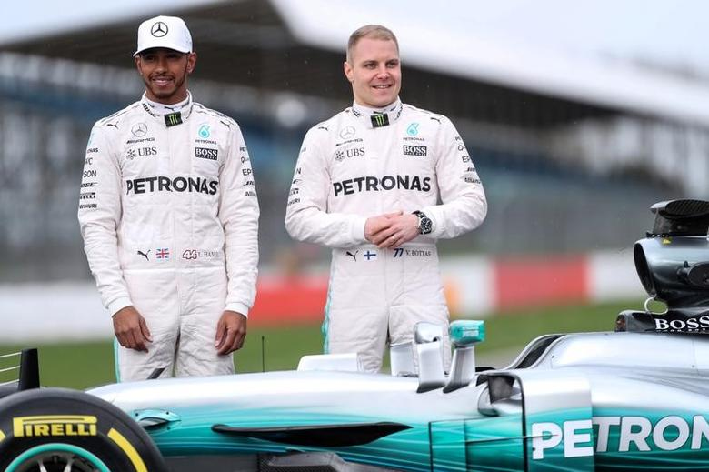 Britain Formula One - F1 - 2017 Mercedes Formula One Car Launch - Silverstone - 23/2/17 Mercedes' Lewis Hamilton and Valtteri Bottas pose during the launch.   Reuters/Eddie Keogh Livepic/File Photo