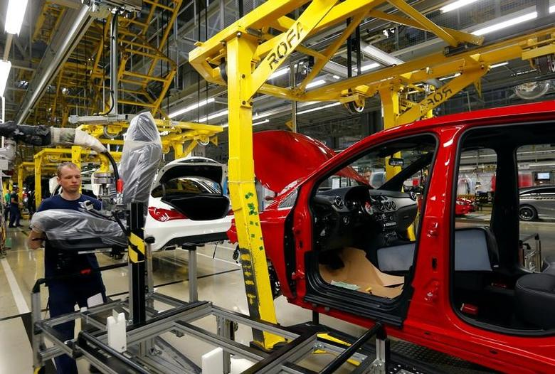 Factory worker assambles car on the assembly line at Daimler's Mercedes factory in Kecskemet, Hungary, April 29, 2016. REUTERS/Laszlo Balogh