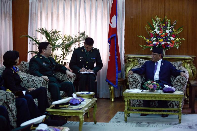 Nepalese Prime Minister Pushpa Kamal Dahal, also known as Prachanda, and Chinese Defence Minister Chang Wanquan are seen during a meeting at the Prime Minister's official residence in Kathmandu, Nepal March 23, 2017. REUTERS/Navesh Chitrakar