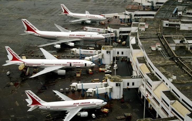 An aerial view of Air India planes parked at Bombay airport August 4, 2005. REUTERS/Punit Paranjpe/Files