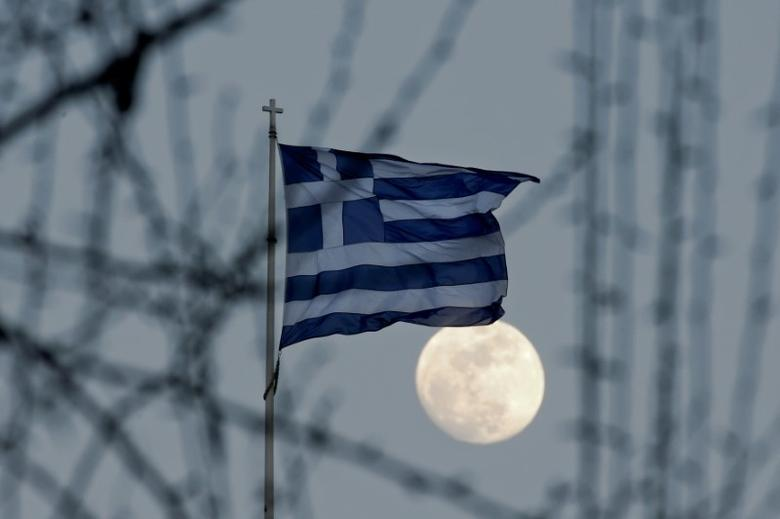 FILE PHOTO:A Greek national flag flutters as the moon rises in Athens, Greece February 9, 2017. REUTERS/Alkis Konstantinidis/File Photo