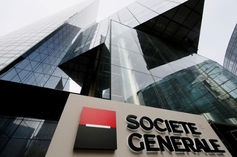 The logo of the French bank Societe Generale is seen in front of the bank's headquarters building at La Defense business and financial district in Courbevoie near Paris, France, April 21, 2016. REUTERS/Gonzalo Fuentes/File Photo